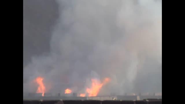 at least ten civilians were killed and dozens injured on saturday when explosions took place inside the largest arms depot in yemen's southern city... - yemen bildbanksvideor och videomaterial från bakom kulisserna