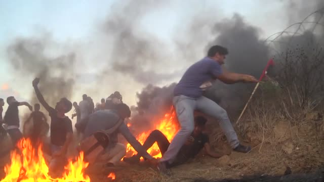 at least three palestinians including a child were killed on friday by israeli army gunfire near the gazaisrael buffer zone eight other palestinians... - israel palestine conflict stock videos & royalty-free footage
