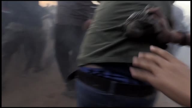 stockvideo's en b-roll-footage met at least three palestinians were killed friday by israeli army gunfire and another 126 injured amid ongoing demonstrations along the gazaisrael... - israëlisch palestijns conflict