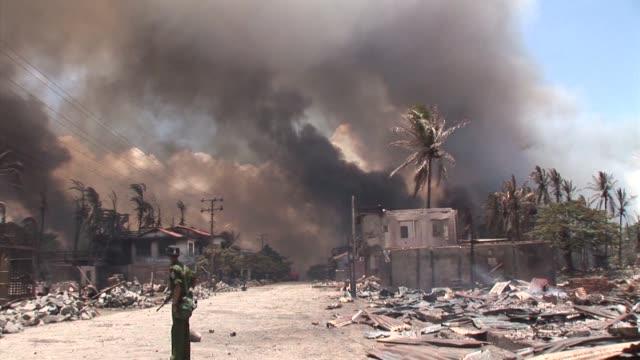 at least three people have been killed in a fresh outbreak of communal violence between muslim rohingya and buddhists in myanmar's western rakhine... - rohingya kultur stock-videos und b-roll-filmmaterial