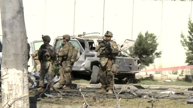 at least three soldiers with the natoled international alliance were killed and 13 civilians injured in the attack in kabul when a suicide car bomb... - kabul stock-videos und b-roll-filmmaterial