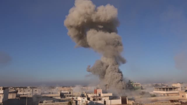 stockvideo's en b-roll-footage met at least two civilians were killed as syrian regime conducted airstrikes with barrel bombs in several districts in idlib province on december 18,... - bom