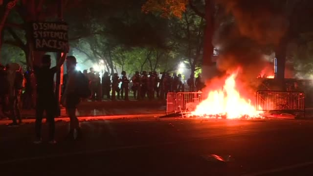 at least two fires are lit near the white house in washington d. c., as protesters gather to voice their fury following the death of george floyd at... - protestor stock videos & royalty-free footage