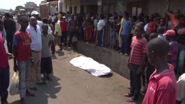 at least two people a policeman and a civilian were killed in a string of explosions and gunfire overnight in the burundi capital bujumbura - violence stock videos & royalty-free footage