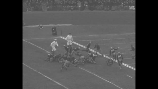 at memorial stadium in philadelphia, navy kicks to army during annual football game; army receiver makes good return / army advances / army drive to... - インターセプト点の映像素材/bロール