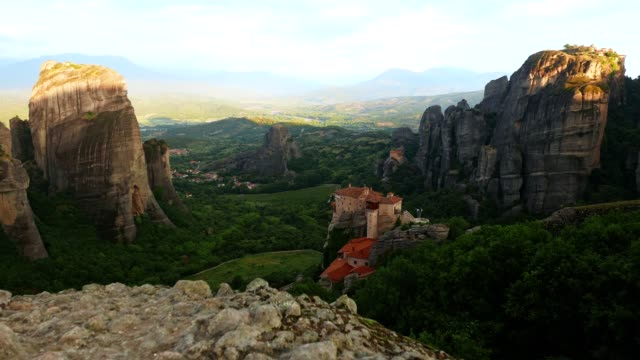 POV at Meteora cliffs, springtime over the Meteora monasteries site, famous places in Greece, travel destinations, UNESCO world heritage site