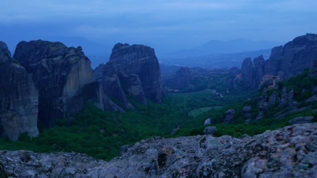 POV at Meteora cliffs, springtime over the Meteora monasteries site, night scene, famous places in Greece, travel destinations, UNESCO world heritage site