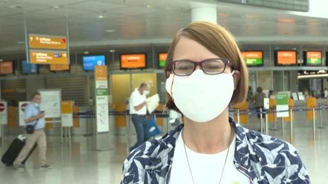 stockvideo's en b-roll-footage met at munich airport, which is still operating in slow motion because of the new coronavirus crisis, a lufthansa employee and agil union representative... - münchen vliegveld