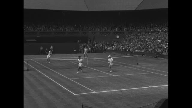 Jack Kramer Bob Falkenburg Tony Mottram and William Sidwell at Wimbledon men's doubles competition / winning shot of doubles final between Kramer...