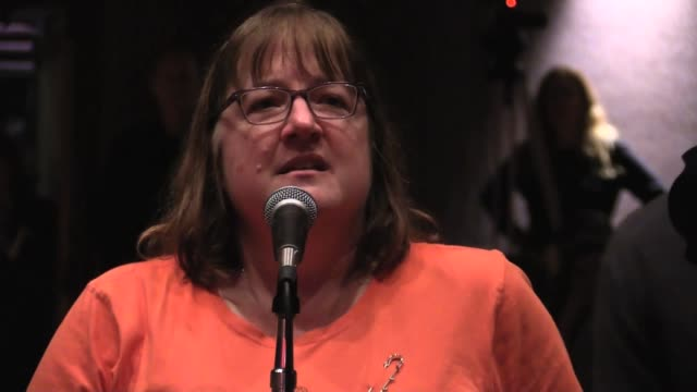 At New Jersey Town Hall woman talks about her degenerative disease and that her medical costs are $9000 a week / In two years she will be dead...