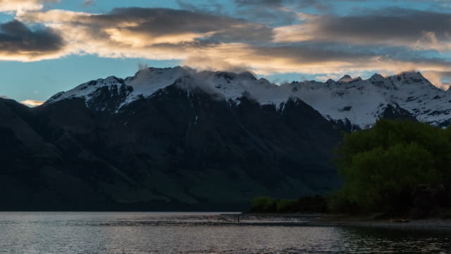 d2d t\l at new zealand nature landscape at wakatipu lake, queenstown - dawn to day stock videos & royalty-free footage