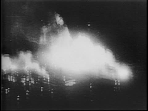 at night, allied bombers drop bombs on german targets / explosions and white smoke illuminate the night / low angle bomber flies just over treetops. - angle stock videos & royalty-free footage