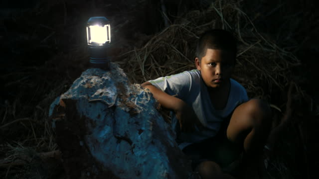 at night ,asian boy who suffer from natural disasters with a sad face - save the children stock videos & royalty-free footage