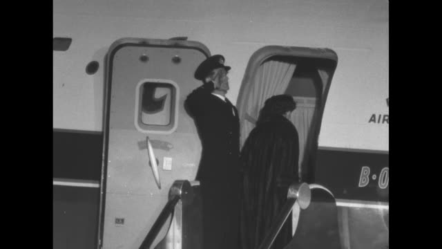 """at night boac stratocruiser """"canopus"""" airplane on tarmac, people on risers, crowd of people on lit tarmac / plane and crew at bottom of stairs / from... - royal tour stock videos & royalty-free footage"""