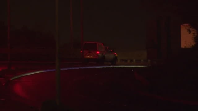 at night, private ambulances remove the bodies of the 39 migrants from the lorry trailer at the port of tilbury docks - east asian ethnicity stock videos & royalty-free footage