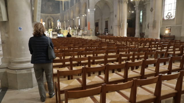 at notredamedeschamps church easter mass is recorded and transmitted live around 350 people watch live and 1600 people follow the videos on church's... - live sendung stock-videos und b-roll-filmmaterial