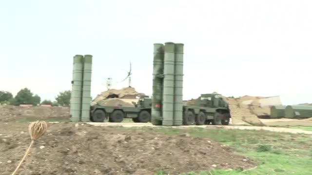At one end of the runway of Russias Hmeimim base in Syria the radars of the most modern air defence system the Russian army posseses the S400 rotates...