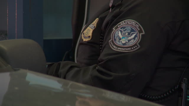 / at otay mesa port of entry, customs & border protection agents check documents of drivers and passengers before letting them enter the country - coast guard stock videos & royalty-free footage