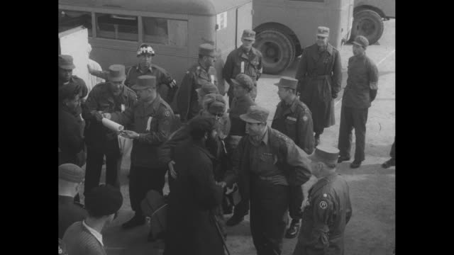 at panmunjom ambulances are lined up containing justreleased us pows from korean war with us soldiers standing and waiting / door of ambulance is... - prisoner of war stock videos & royalty-free footage