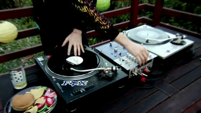 cu zo dj at party on outdoor deck playing records and turning knobs on mixer/ los angeles, california - knob stock videos & royalty-free footage