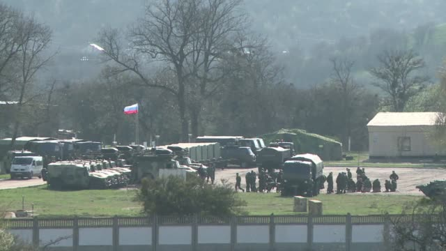 at perevalne military base in crimea russian soldiers along with dozens of military vehicles were deployed thursday clean : russian forces tighten... - military base stock videos & royalty-free footage
