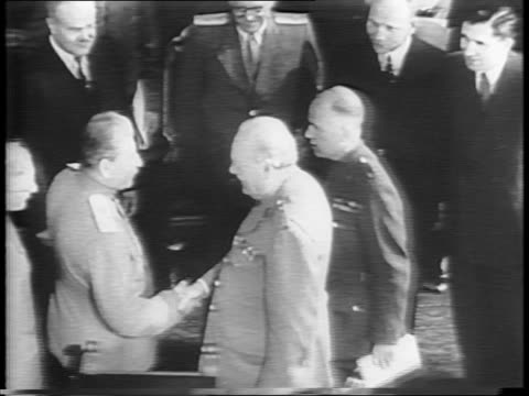 at potsdam, president harry s truman walking with prime minister winston churchill, they shake hands / view of inside the conference / joseph stalin... - potsdam brandenburg stock videos & royalty-free footage