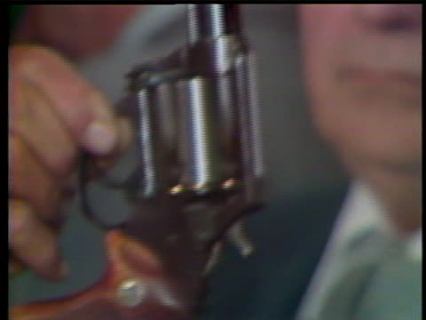 at press conference, a man is seen holding up the .44 caliber serial killer david berkowitz, or son of sam used for the photographers. there's a on... - msnbc stock videos & royalty-free footage