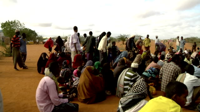at refugee camp UN officer with loudspeaker and refugee crowd on July 30 2011 in Dadaab Kenya