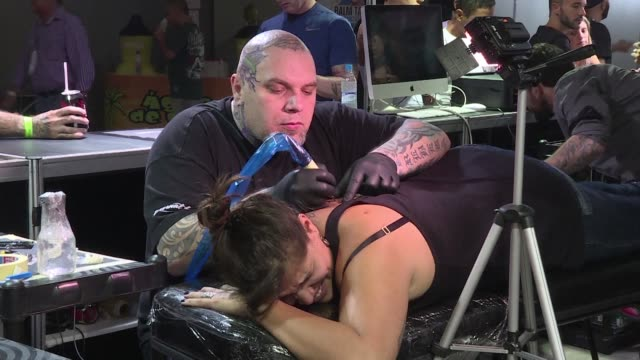 at rio tattoo week 2016 billed as latin america's biggest piercing and tattoo convention the image of death stared out from arms legs necks and most... - tattoo stock videos and b-roll footage