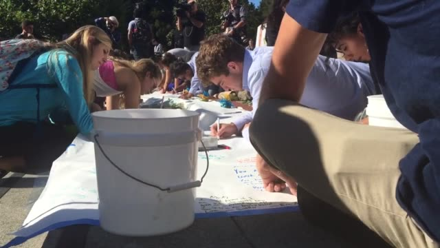 at sproul plaza at sproul plaza students sign condolences at a vigil for nice terror attack victim nicolas leslie. french consul general emmanuel... - terrorismus stock-videos und b-roll-filmmaterial