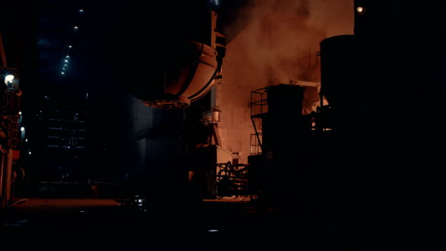 at steel mill. van with melten metal going out of blast furnace - acciaieria video stock e b–roll