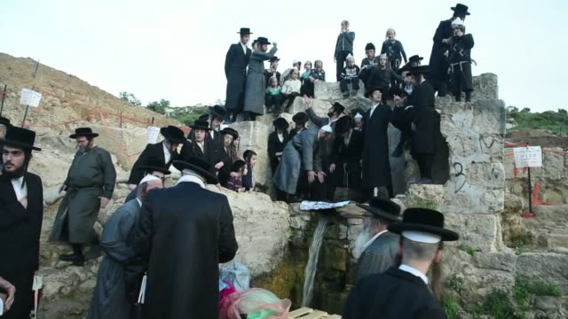 at sunset ultra orthodox jews collected water from a mountain spring at the outskirts of jerusalem towards passover holiday which commemorates the... - biblical event stock videos & royalty-free footage