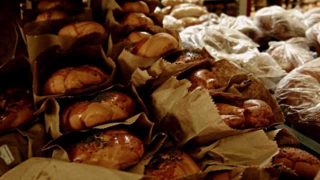 at the bakery. rows of fresh, puffy challah - bun stock videos & royalty-free footage