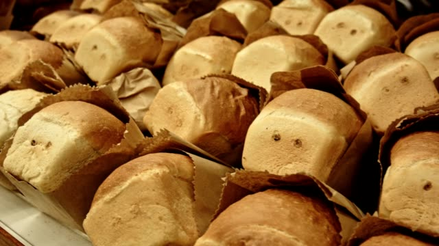 at the bakery. shelf with loaves of white bread - white bread stock videos and b-roll footage