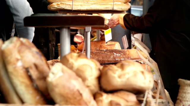 at the bread stand - french culture stock videos & royalty-free footage