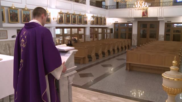 at the call of the polish episcopate to fight the epidemic of coronavirus catholic worshippers remain at home to pray on sunday leaving priests who... - priest stock videos & royalty-free footage
