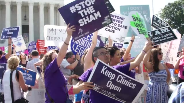 at the end of the 2015 term, the supreme court issued a decision striking down a restrictive texas law regarding access to abortion care. on the... - supreme court stock videos & royalty-free footage