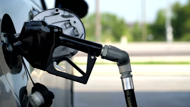 at the gas pump - refuelling stock videos & royalty-free footage