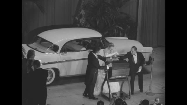 at the imperial ball a night in monte carlo prince rainier spins the handle of a hopper and his fiancee grace kelly opens it to remove the winner of... - monaco royalty stock videos and b-roll footage