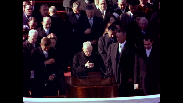 / at the podium for john f kennedy's inauguration / cardinal richard cushing gives invocation and jfk and others genuflect / begins a prayer for the... - john f. kennedy us president stock videos & royalty-free footage