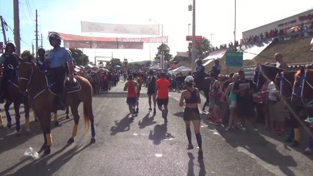 at the san blas halfmarathon in puerto rico elite runners lead the way through downtown coamo passing through massive crowds center of town crowds... - salmini 個影片檔及 b 捲影像