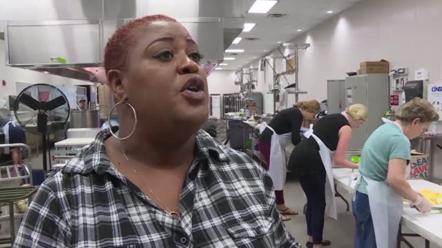 at the second harvest food bank in a new orleans suburb staff and volunteers many themselves katrina survivors are receiving cooking and packaging... - survival stock videos and b-roll footage