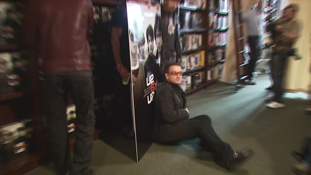 u2 at the u2 signs copies of their new book 'u2 by u2' at barnes noble union square in new york new york on september 26 2006 - barnes & noble stock videos and b-roll footage