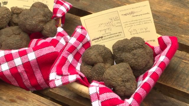At the winter black truffle wholesale market in Lalbenque in southwestern France growers say they're feeling the heat from competition from Spain...