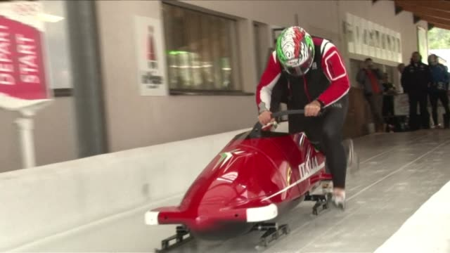 at the winter olympic games in sochi the italian bobsleigh team will be the envy of their competition as they will be racing a ferrari clean italian... - bobsleighing stock videos & royalty-free footage