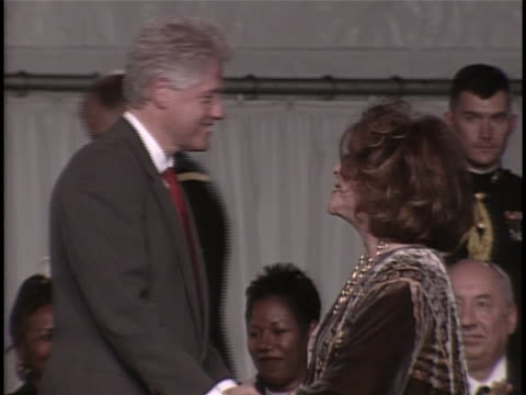 at white house ceremony us president bill clinton presents presidential citizens medal to elizabeth taylor for her work on aids research and care - societal symbol stock videos & royalty-free footage