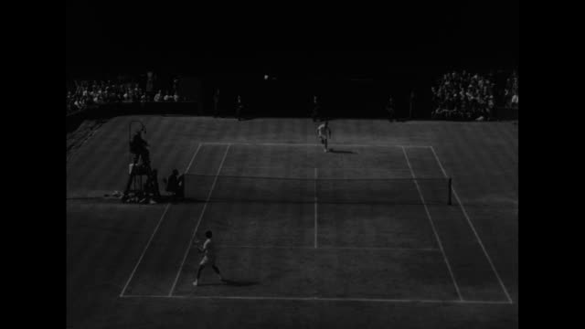 at wimbledon tennis players american shirley fry and briton angela buxton leave the court carrying flowers / australians lew hoad and ken rosewall... - zia video stock e b–roll