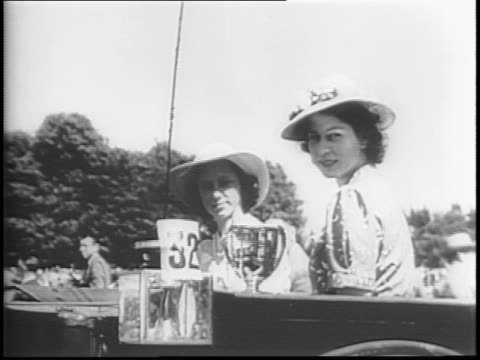 at windsor castle horsedrawn carriages put on a show as king george vi and the royal family officiate / princess elizabeth with princess margaret... - principessa margaret contessa di snowdon video stock e b–roll