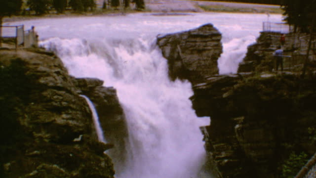 athabasca falls signage / family observing the falls / zoom on rushing water / athabasca falls in alberta on may 01 1971 in jasper alberta - athabasca falls stock videos and b-roll footage