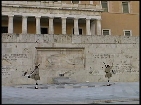 athens: changing of the guard: evzones guards at parliament.  greece - honour guard stock videos & royalty-free footage